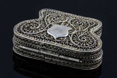 elegant antique small silver casket for jewelry isolated on black background with reflection. Work of an unknown jeweler 18th century, Armenia