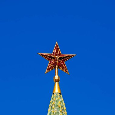 Red ruby star on top of Moscow Kremlin tower. Russia. UNESCO World Heritage Site. Blue sky background