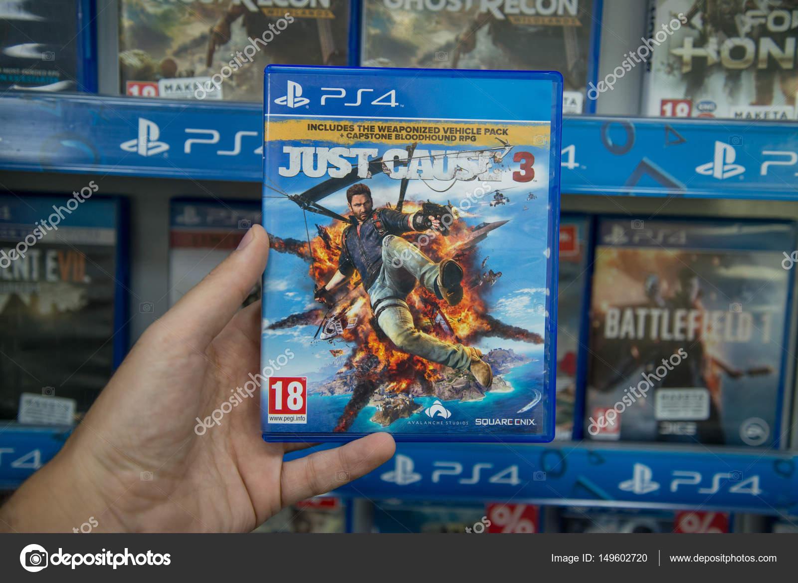 Just Cause 3 Jeux Vido Sur Sony Playstation 4 Photo Ditoriale Ps4 Gold Edition Bratislava Slovaquie Vers Avril 2017 Homme Tenant Juste Jeu Console En Magasin Image De Pe3check