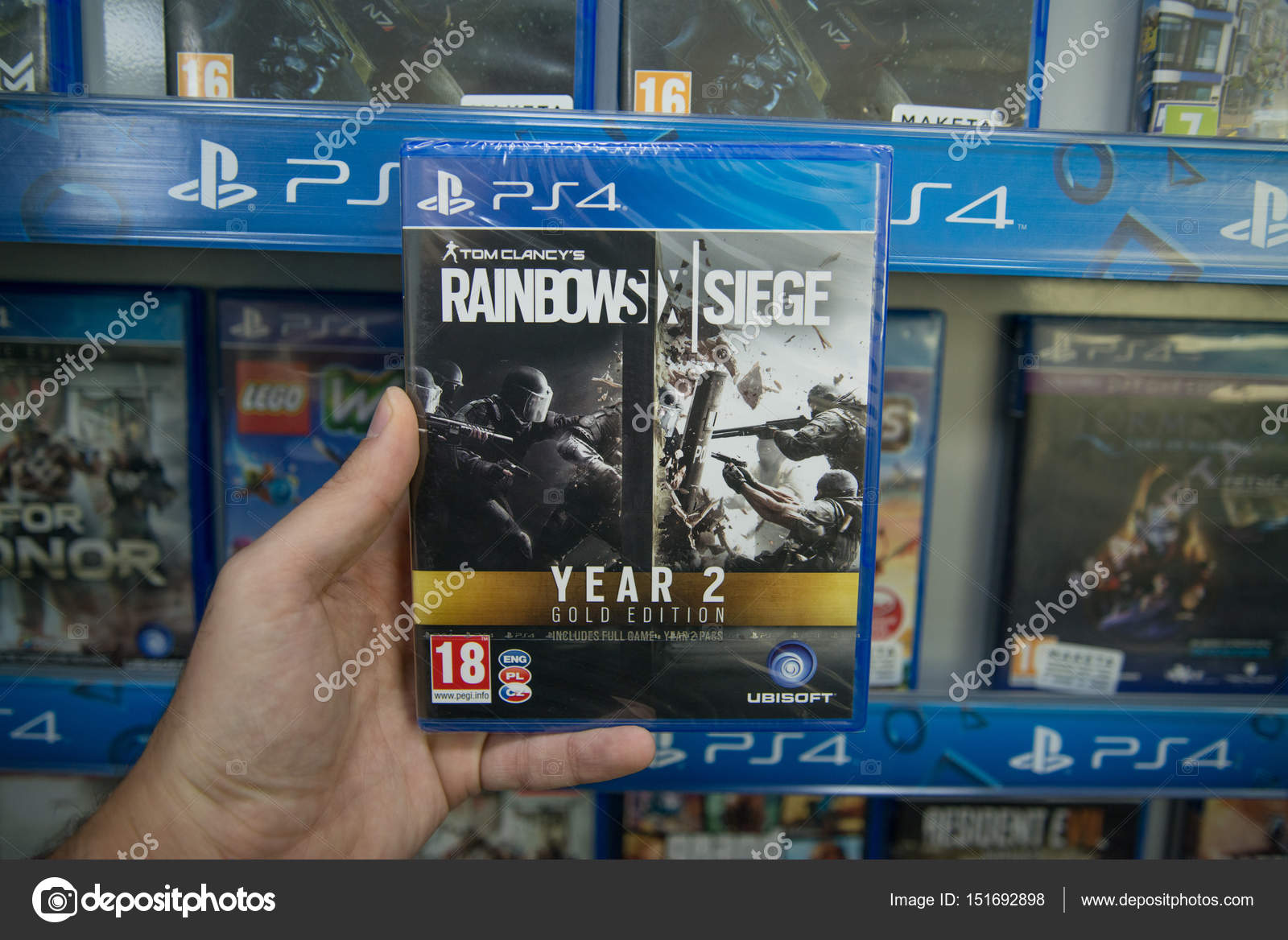 Bratislava, Slovakia, circa april 2017: Man holding Tom Clancy's Rainbow six siege year 2 gold edition videogame on Sony Playstation 4 console in store ...