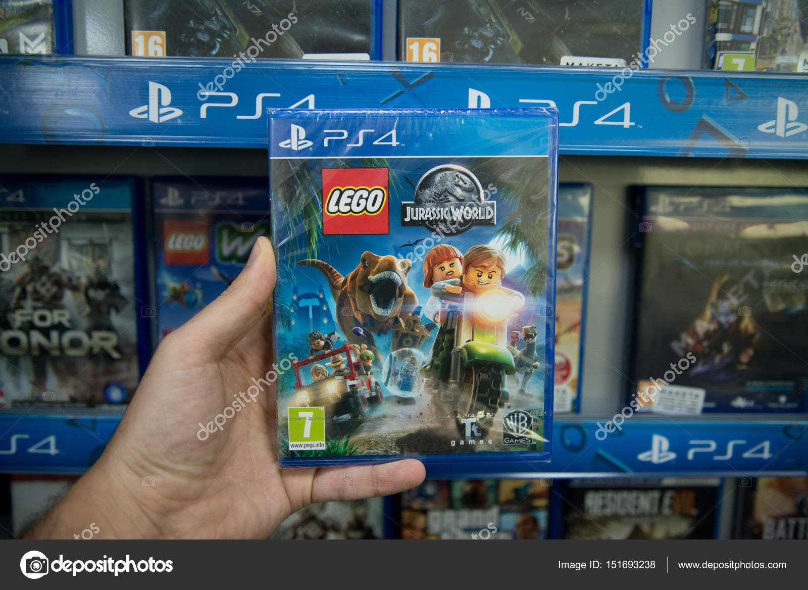 Lego Jurassic World Videogame On Sony Playstation 4 Stock Ps4 Bratislava Slovakia Circa April 2017 Man Holding Console In Store Photo By Pe3check
