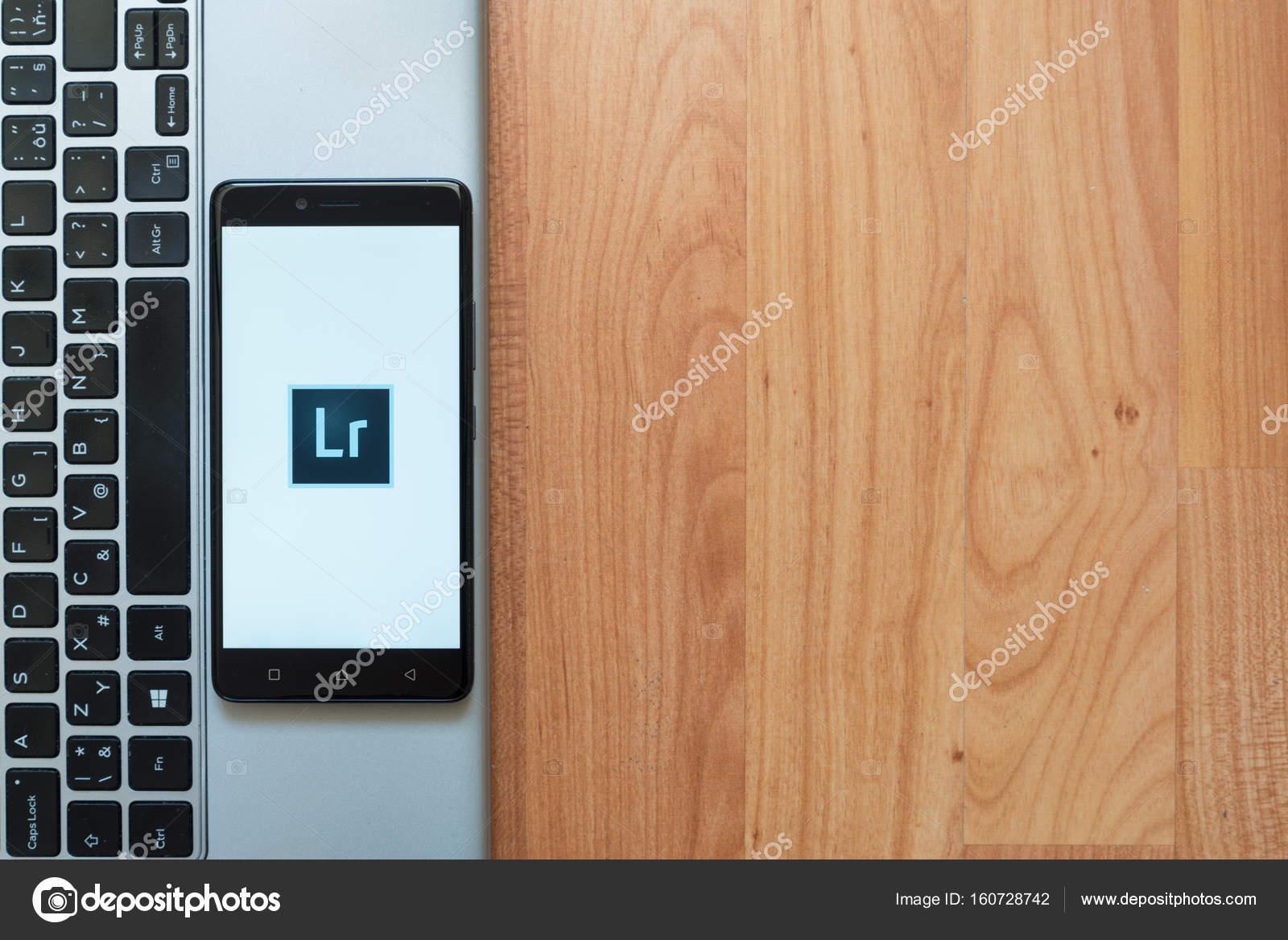 Adobe photoshop lightroom logo on smartphone – Stock