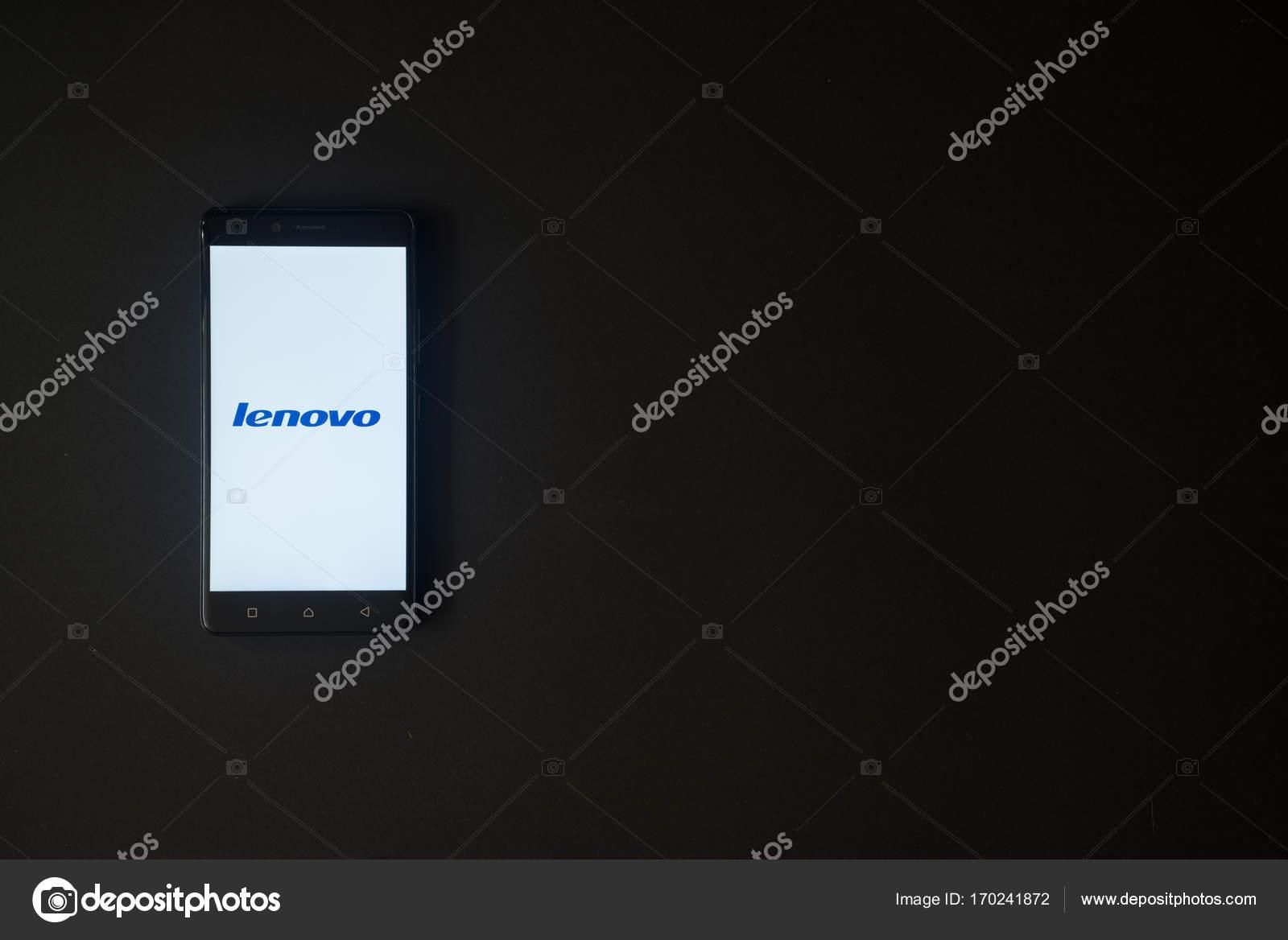 Lenovo logo on smartphone screen on black background – Stock