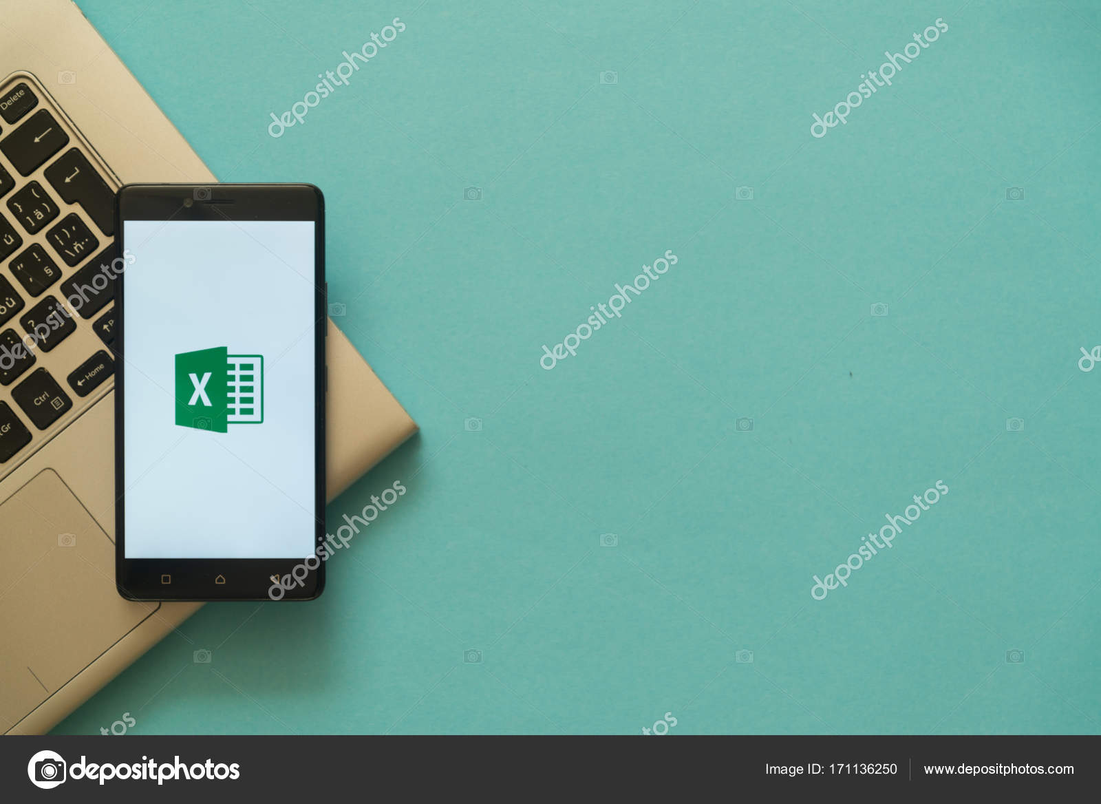 microsoft office excel logo on smartphone placed on laptop keyboard stock photo
