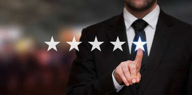 Five stars rating with a businessman touching screen, concept about positive customer feedback and review