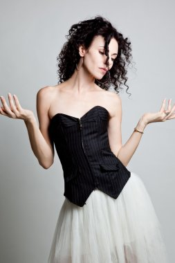 Curly elegant woman in a corset
