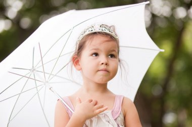 Princess in the park with umbrella