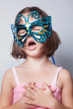 Little girl in carnival mask