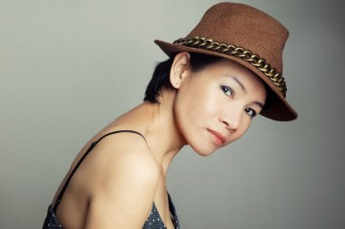 stylish asian woman in hat
