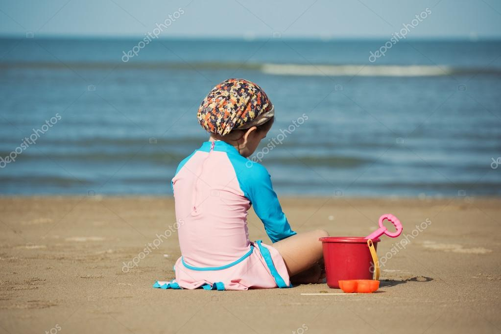 Girl sitting on the beach