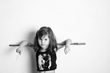 Little girl with stick