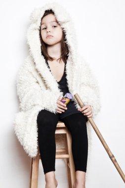 Llittle actress sitting on chair