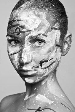 Woman artist in paint
