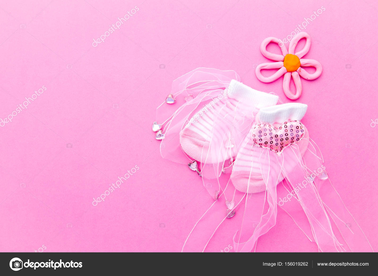 Baby Girl - pink and white socks with flower on pink background — Stock Photo