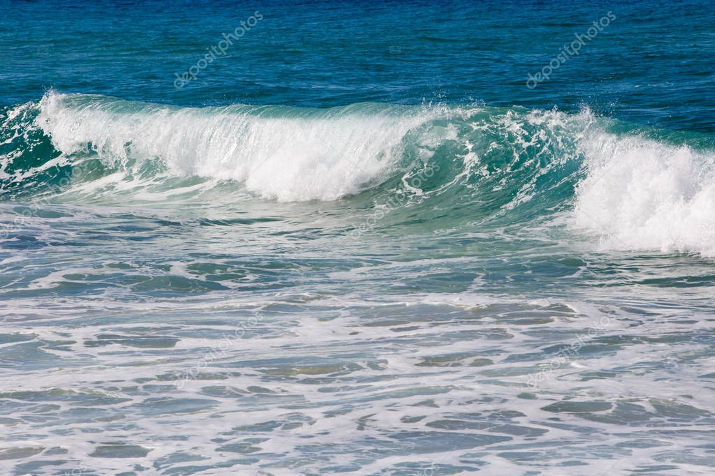 Incoming surf waves - with blues and greens and white foam