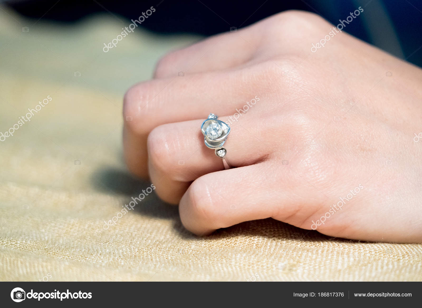 closeup the wedding beautiful diamond ring on women ring finger ...