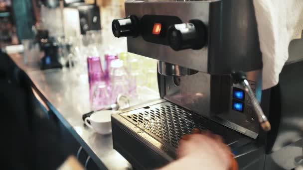 Preparing cups of espresso at a busy coffee shop