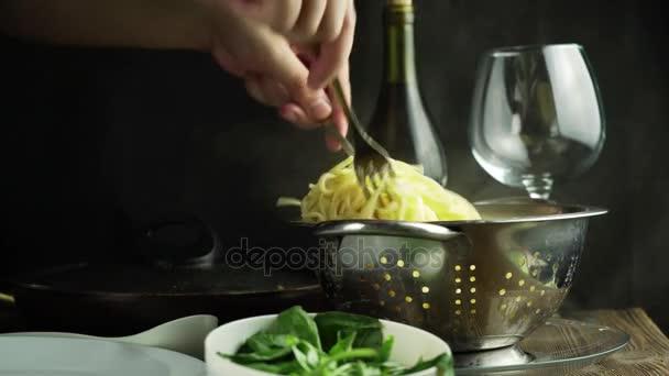 Spaghetti with fresh basil leaves on white dish