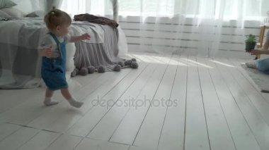 Baby Practicing First Steps