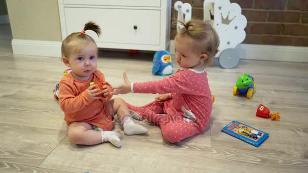 Little children, kids, baby, playing in kindergarten, school. Little girls, female friends playing with toys in preschool, child crying and screaming.