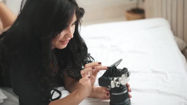 Sensual woman takes a photo of an new camera