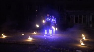 LED show performance in glowing costume at night