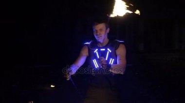 Fire show. Man juggling fire.