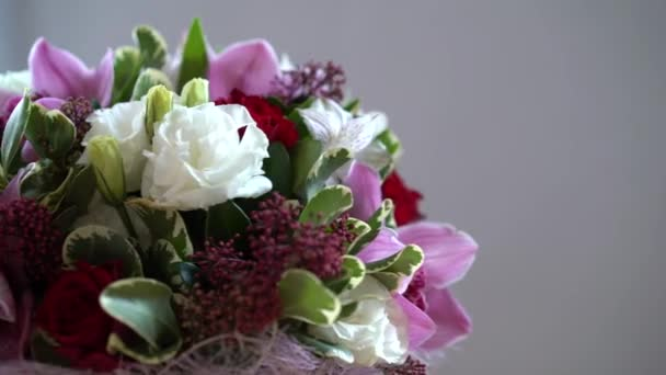 bouquet of flowers moves around, different flowers, roses, tulips, violets.