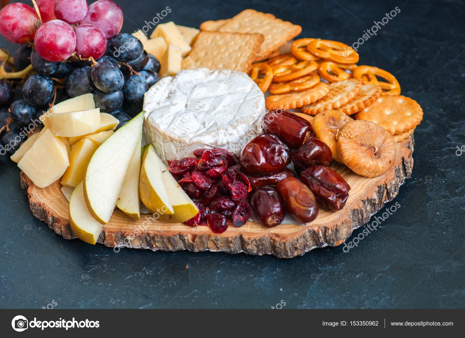 Cheese plate grape salted cracker cookies dry dates cranberry f \u2014 Stock Photo & Cheese plate grape salted cracker cookies dry dates cranberry f ...