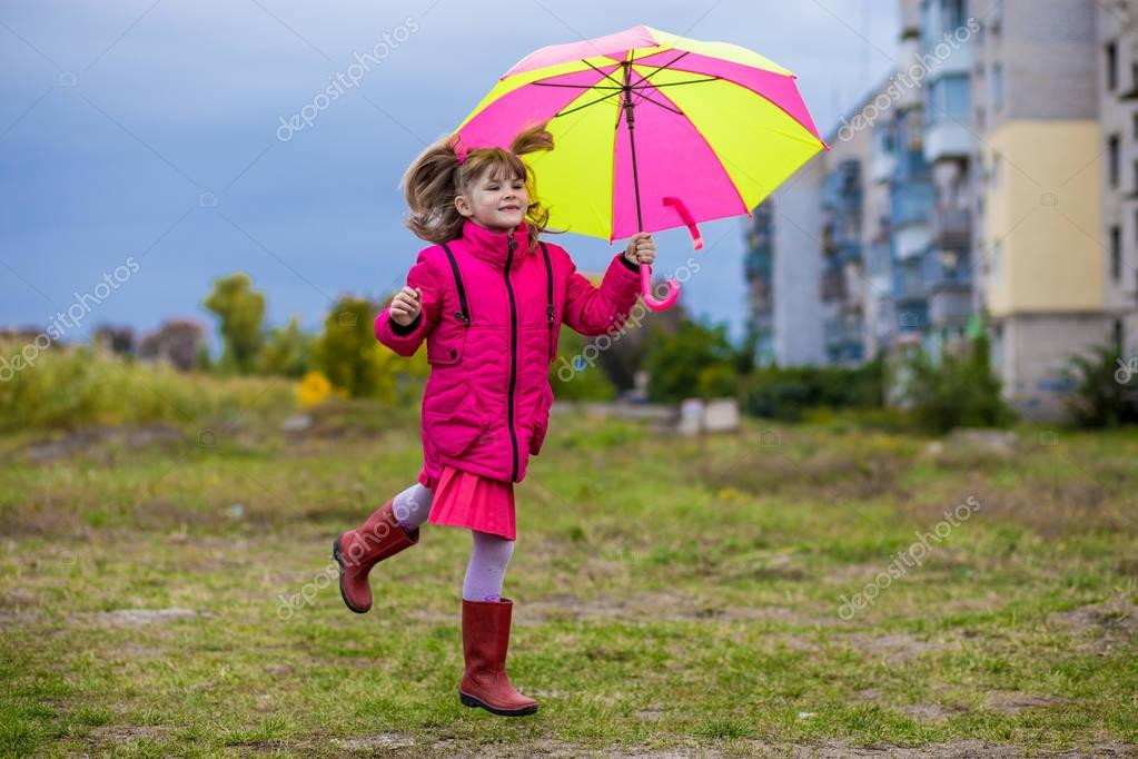 Colorful umbrella cute girl jump funny to sky