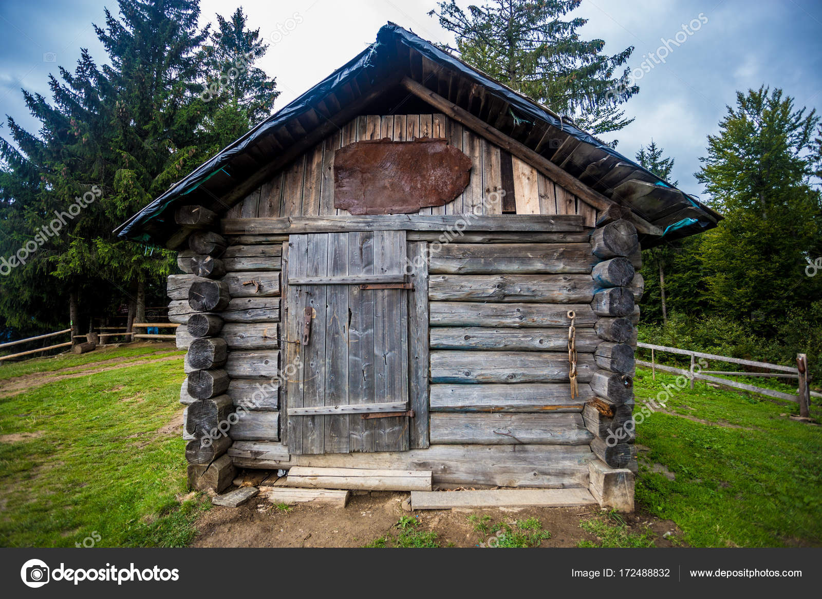 Old Small Wooden House On Top Of A Hill In The Forest Against A Dramatic Sky Background Stock Photo C Svetikpash Mail Ru 172488832