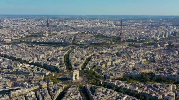 PARIS, FRANCE - MAY, 2019: Aerial drone view of Triumphal Arch and and Eiffel tower in historical city centre.