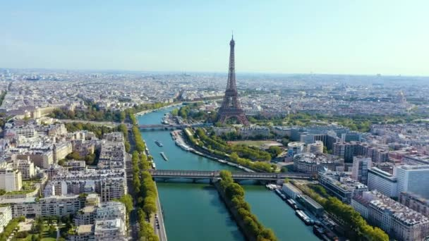 PARIS, FRANCE - MAY, 2019: Aerial drone view of Eiffel tower and Seine river in historical city centre from above.