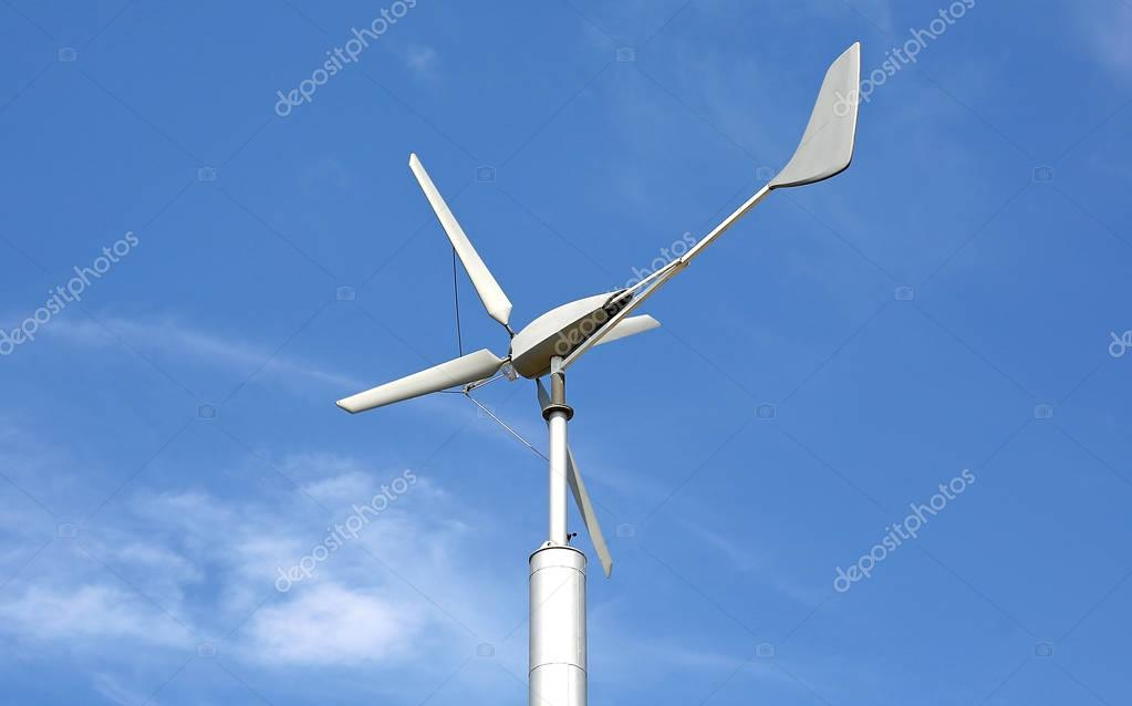 Wind turbine against cloud sky