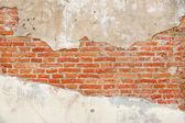 Fotografia Sfondo di texture di muro di mattoni crepa