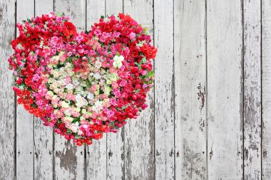 Valentines Day, Heart Made of Roses flower on wood plank background.
