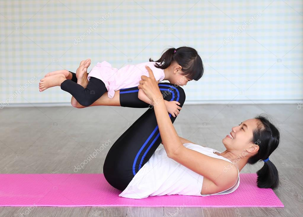 Mother and daughter doing exercise at home