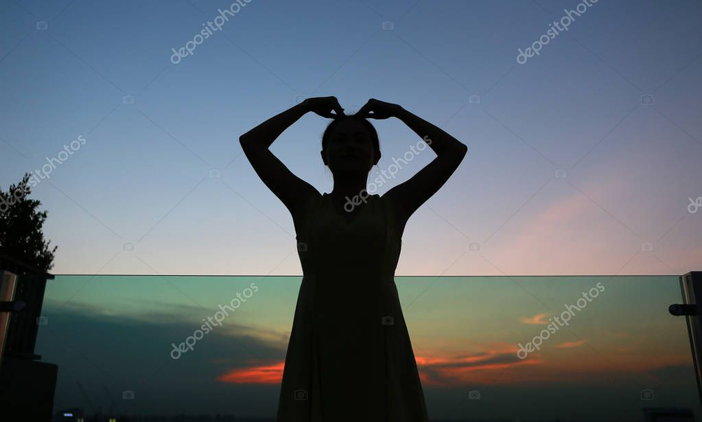 Close up Silhouette of woman expression Heart shape at sunset