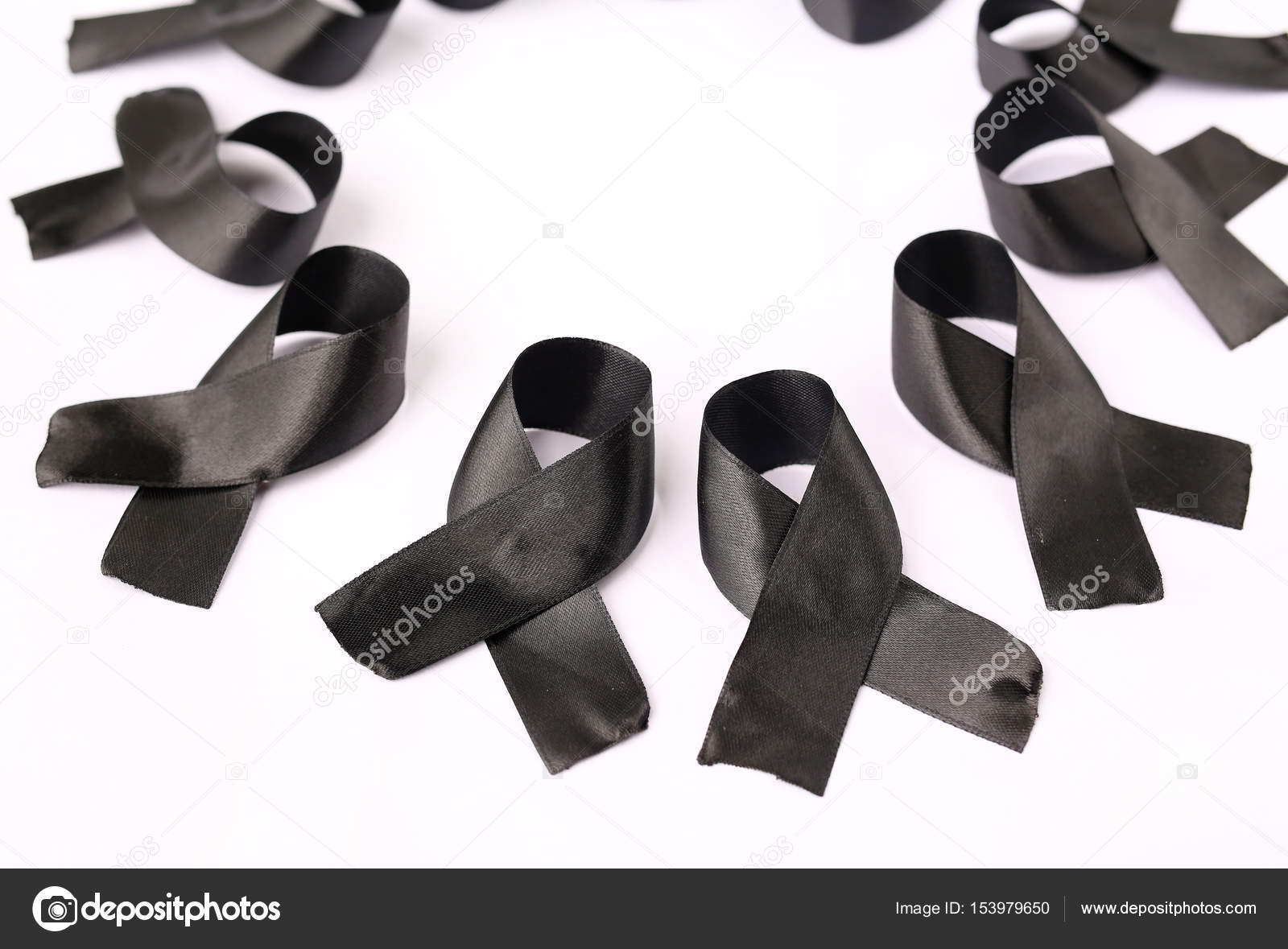 Black ribbon bow fabric texture ribbon awareness symbol of black ribbon bow fabric texture ribbon awareness symbol of remembrance campaign or mourning over persons death pray for world peace concept photo by buycottarizona Gallery