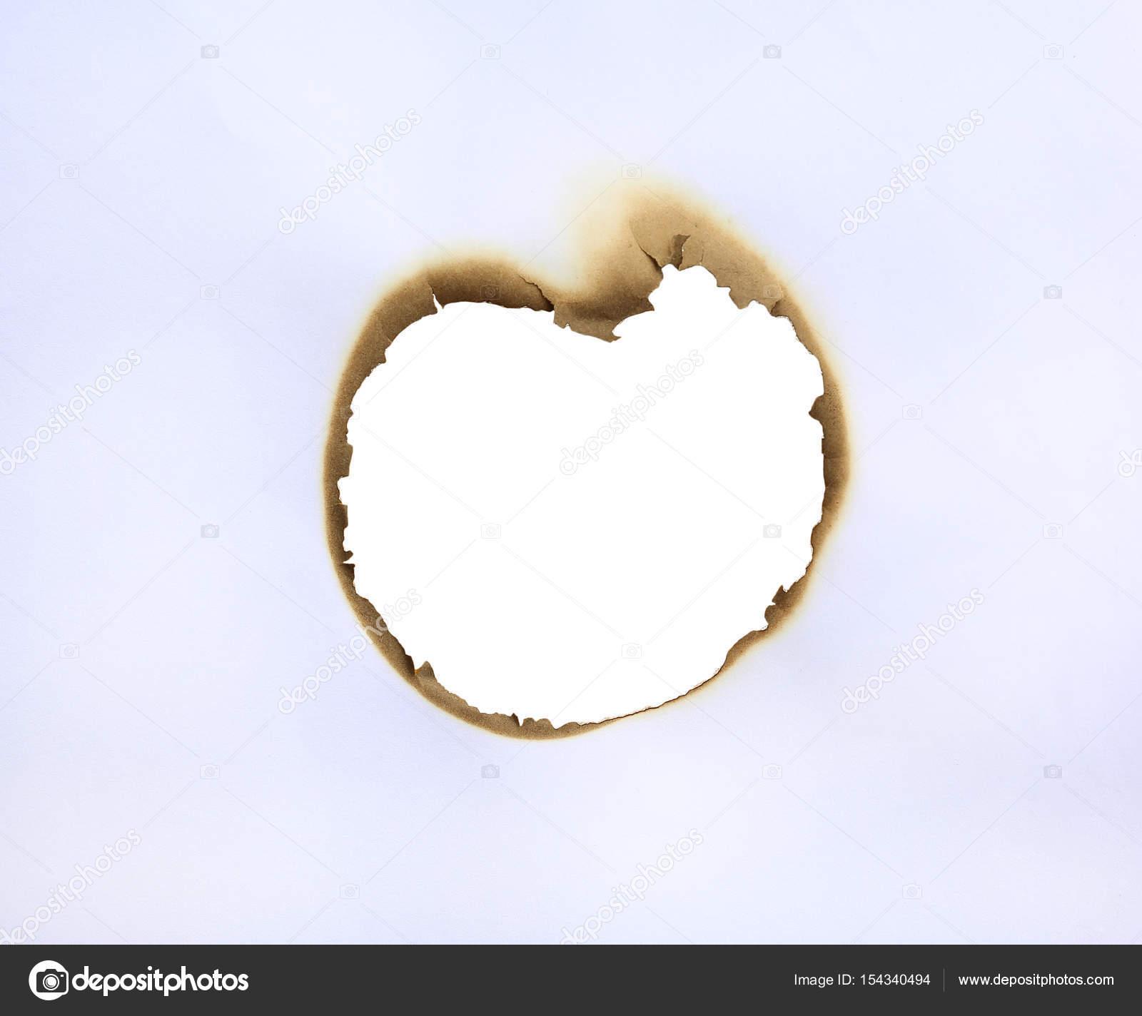 Marco del agujero quemado en el trabajo como un corazón — Foto de ...