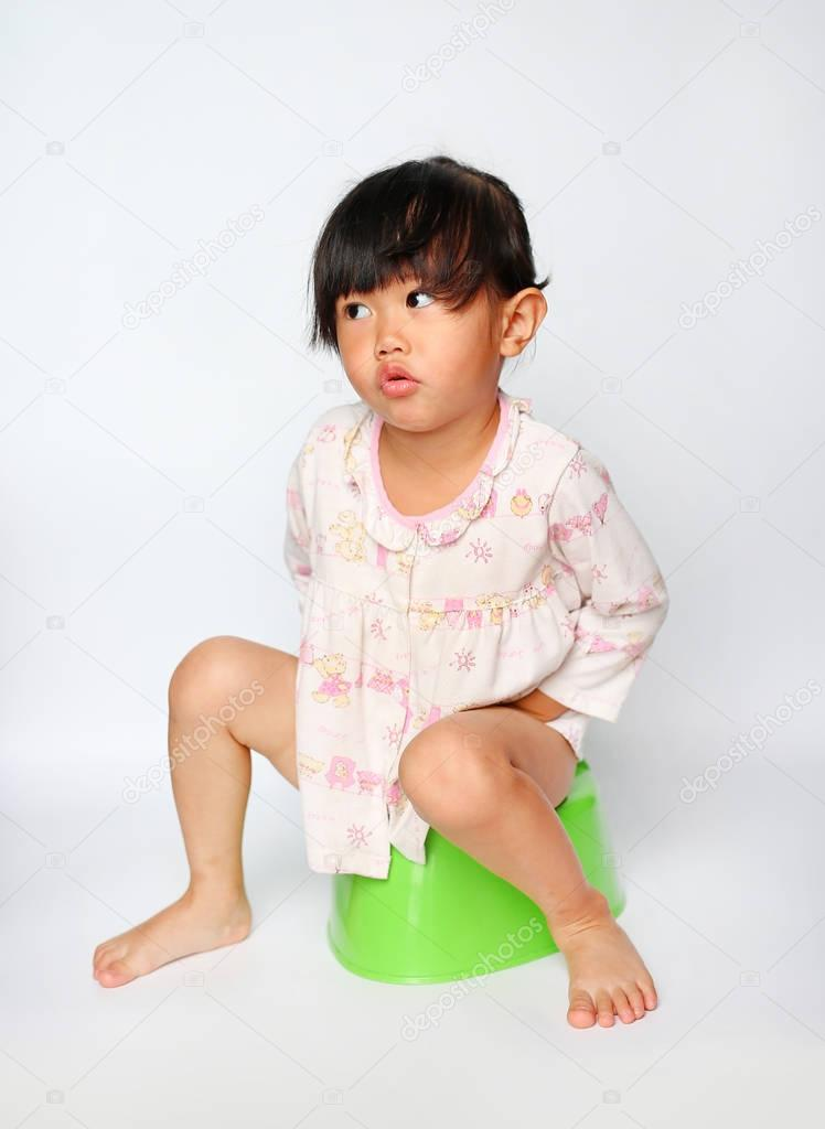 Premium Photo | Little girl sitting on toilet training