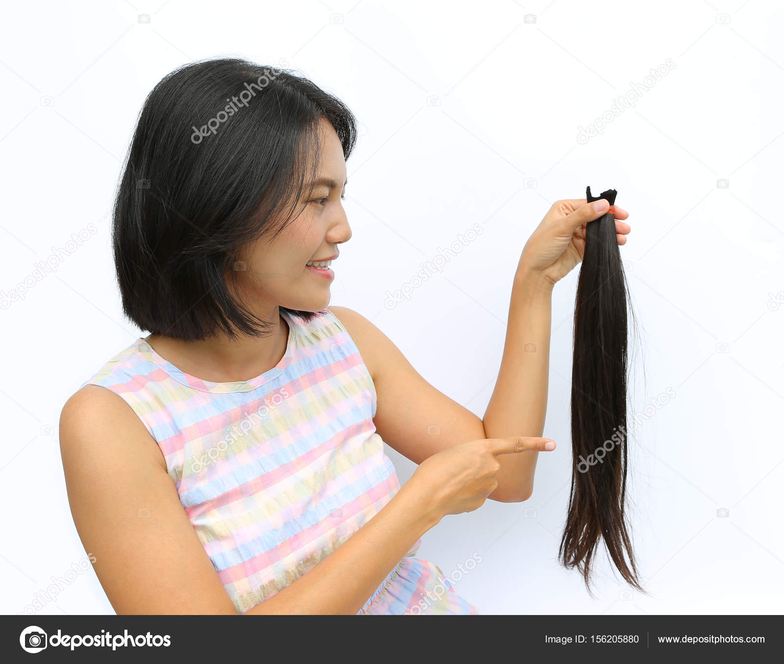 Asian Woman Donating Her Hair To Cancer Patients Holding Her