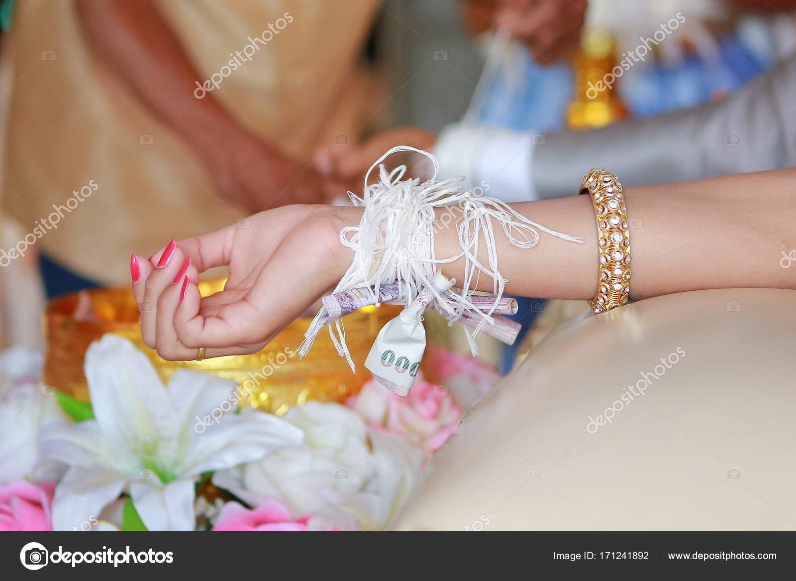 Thai wedding ceremony culture marriage bind holy thread with hand