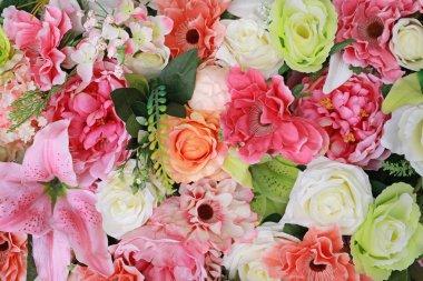 Artificial bouquet flowers background