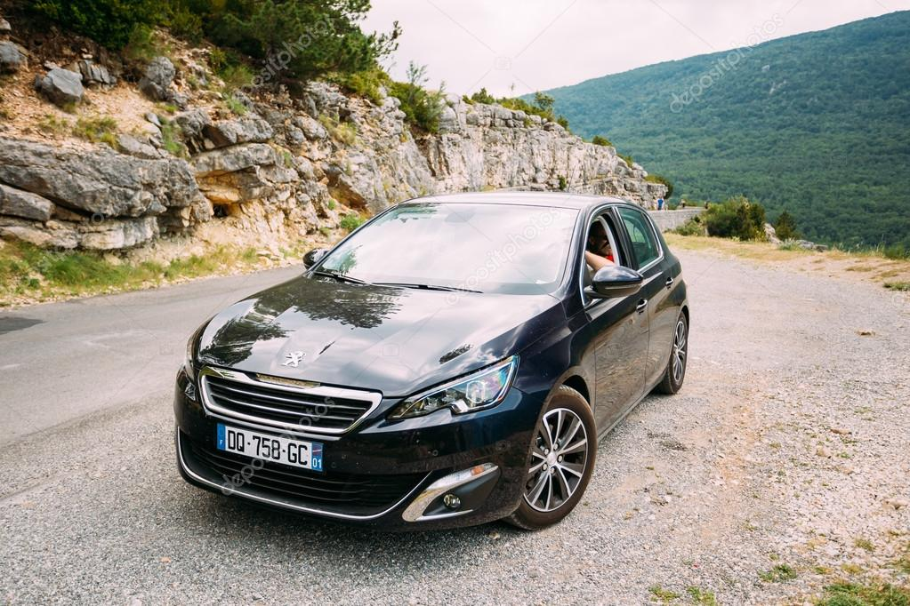 Black colour Peugeot 308 car on background of French mountain ...