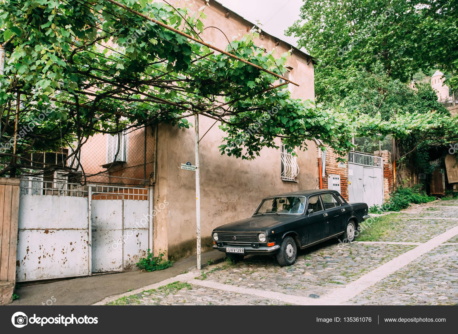 tbilisi georgia may 20 2016 the view of parked black volga gaz retro rarity car near the private residential house under vine canopy on cobbled green - Green Canopy 2016