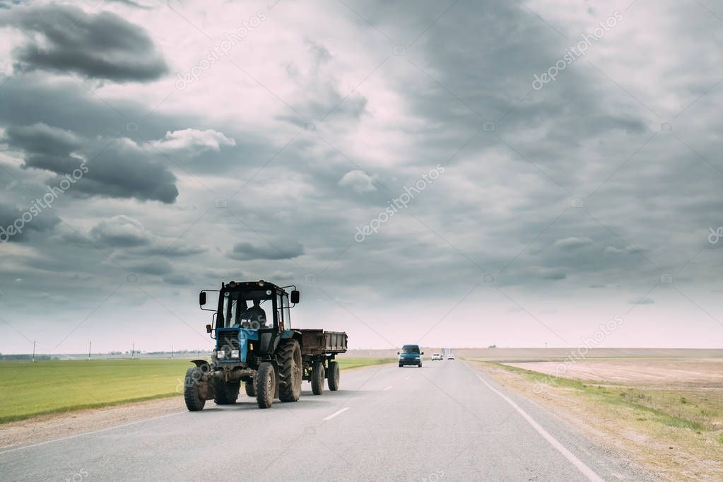 Tractor In Motion On Country Road. Motion Cars On Freeway In Europe