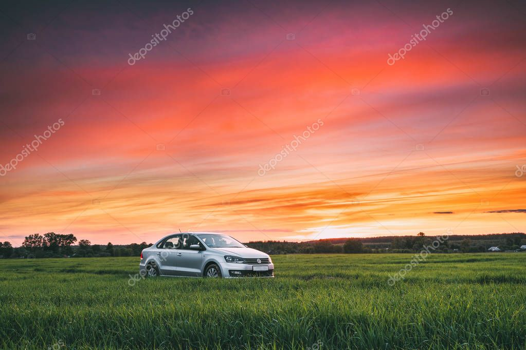 Volkswagen Polo Vento Car Sedan On Country Road In Spring Wheat