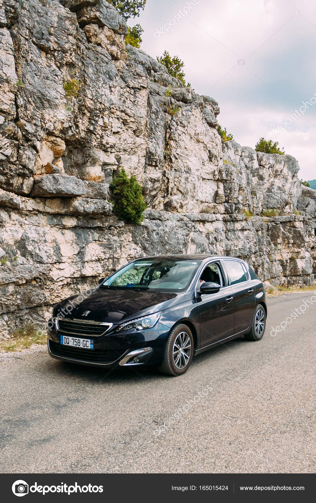 Black colour Peugeot 308 car on background of French mountain nature ...