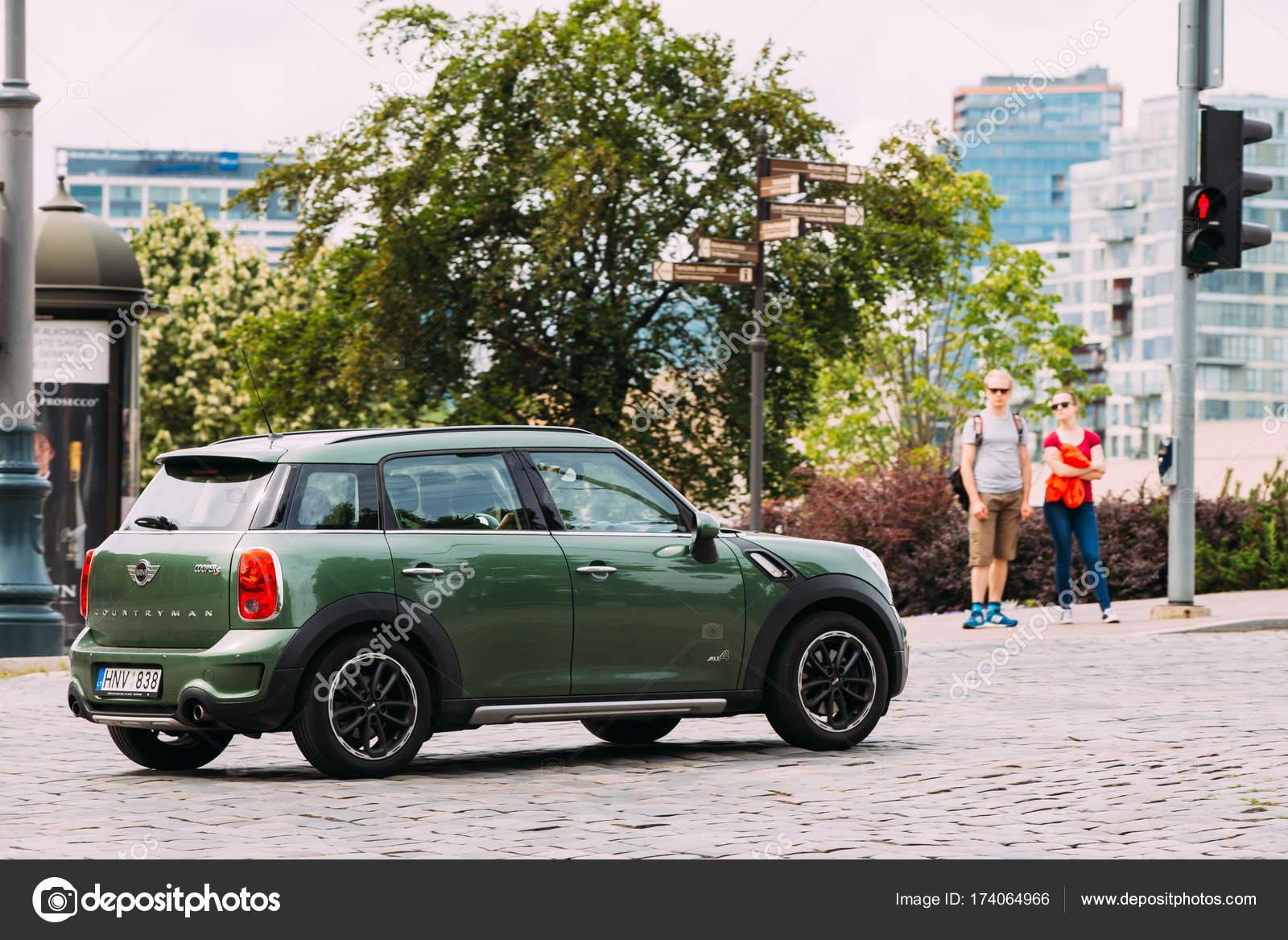 Mini mini cooper crossover : Green Color Car Mini Cooper Mini Countryman Is Moving On Street ...